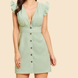 Creamy green plunging v-neck dress